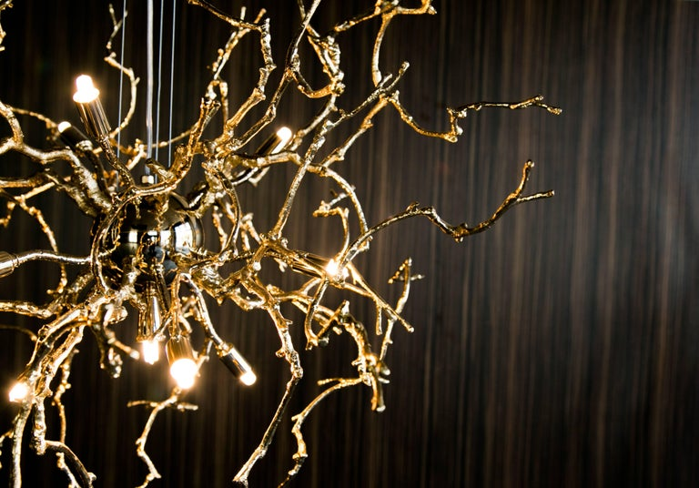 21st century sculptural nodern handmade pendant lamp in brass and lost wax  Pendant lamp Handmade  It created with lost wax technique reproducing wine three branches. Exclusive artwork to illuminate every space.  The sculptor, from the