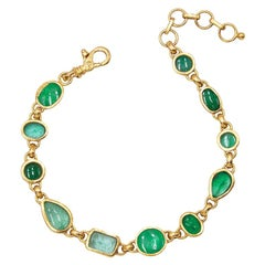 22-24 Karat Hammered Gold and Mixed Shaped Faceted and Cabochon Emerald Bracelet