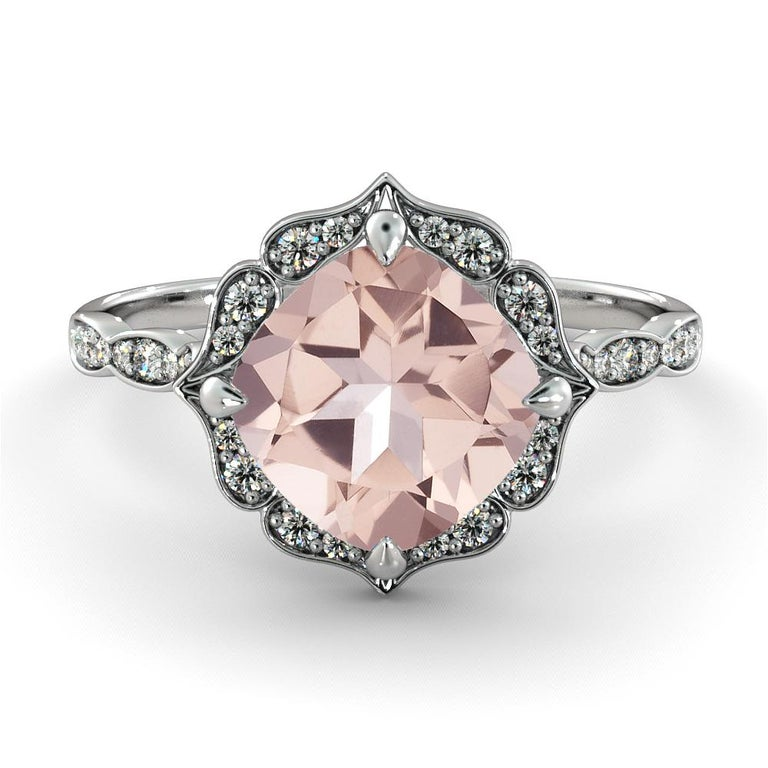 Vintage flower halo setting with beautiful morganite center stone and diamond side stones. Center stone is of 2 carat, natural, cushion, peach/pink color, morganite and it is surrounded with 34 natural diamonds.   Main Stone Name: Morganite Main