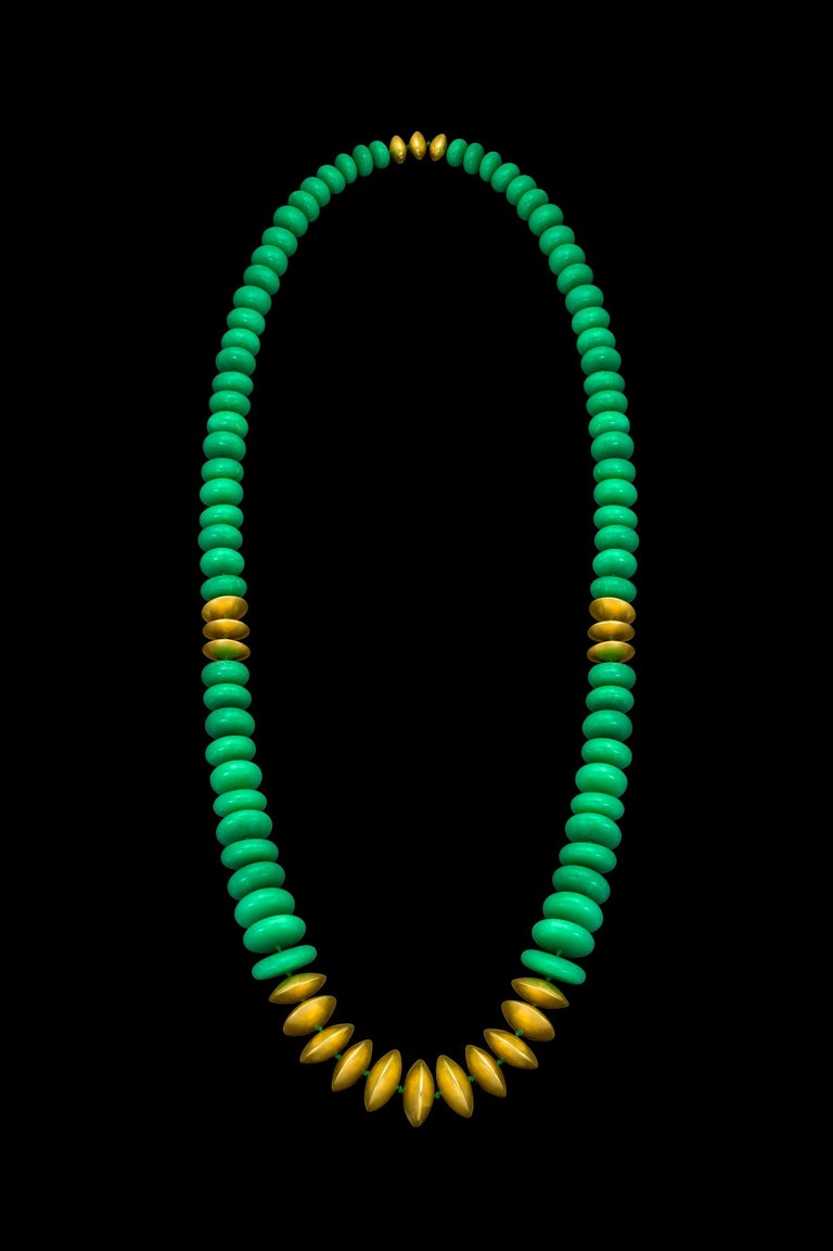 This statement necklace features handmade hollow 22k yellow gold beads and smooth Chrysoprase beads. This Chrysoprase exhibits consistent color with minimal veining making it fine quality material as well an uncommon piece.  The 22k yellow gold is