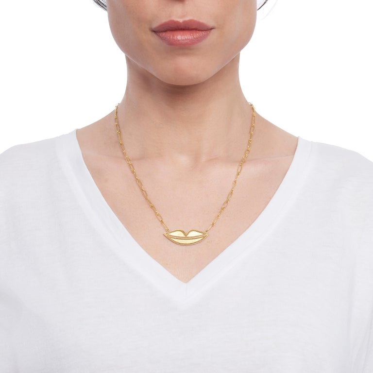 The softly smiling granulated lips of 22 karat yellow gold are a nod to Salvator Dali.  The lips measure 1.5 inches in width and .5 inches in length.  The delicate 22 karat yellow gold link chain is also made by hand and measures 20 inches.