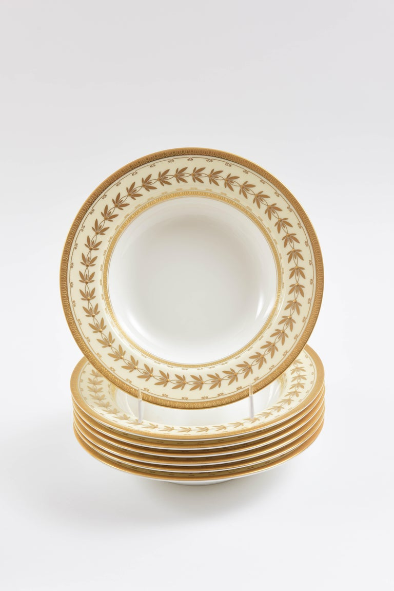 So nice to have a large quantity of the finest quality gilt decorated porcelain bowls. Custom ordered through the fine retailer of Tiffany & Co. Such a practical place piece for soups, pasta, salad, desserts with sauce or ice cream. An elegant