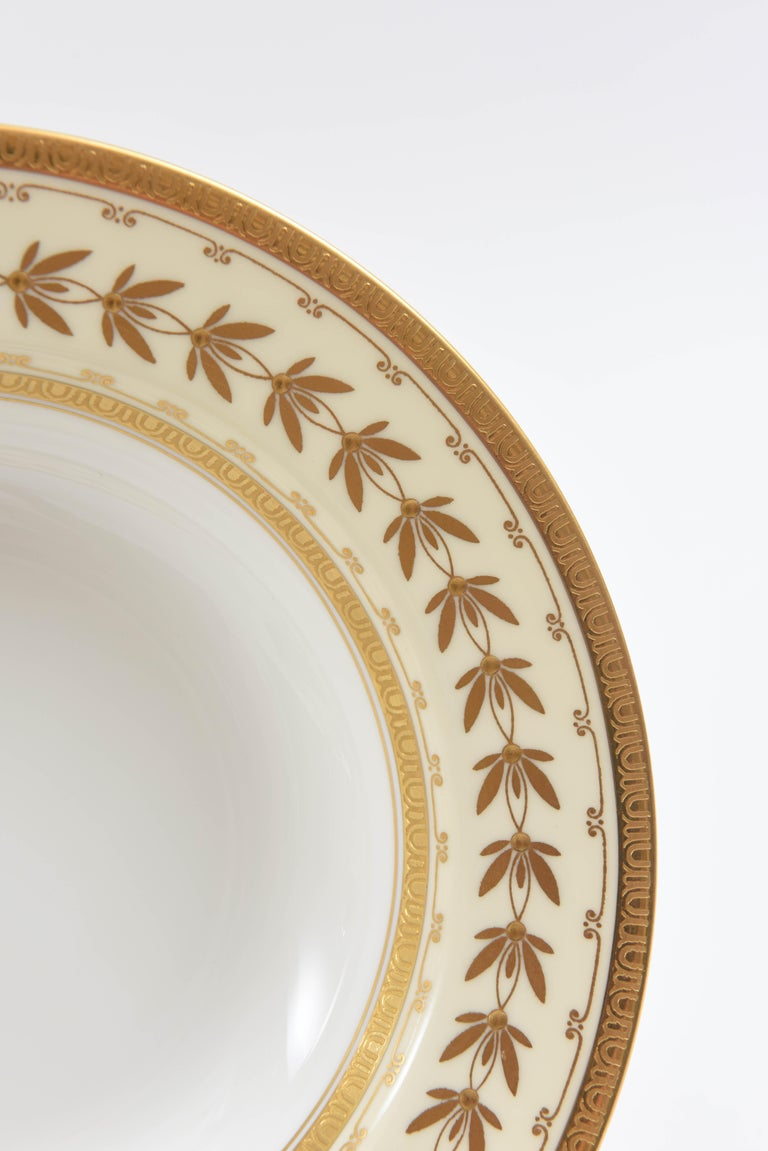 Hand-Crafted 22 Tiffany Porcelain Rim Soup Bowls, Minton England with Raised Tooled Gilding For Sale
