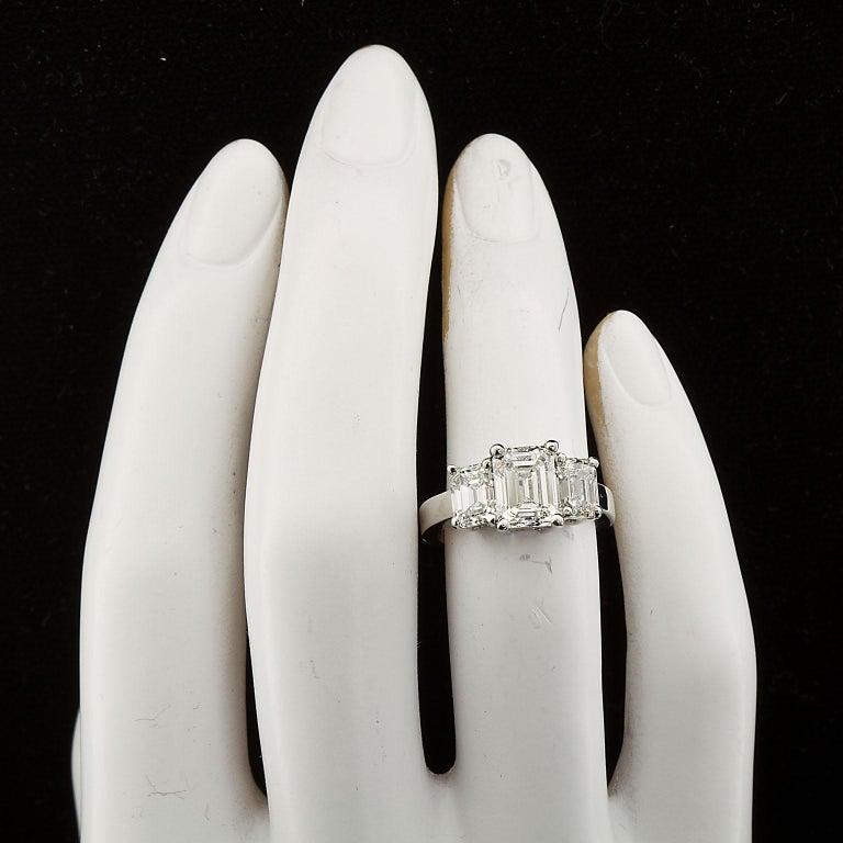 2.20 Carat Centre Three-Stone Emerald Cut Diamond Platinum Ring GIA Certified For Sale 4