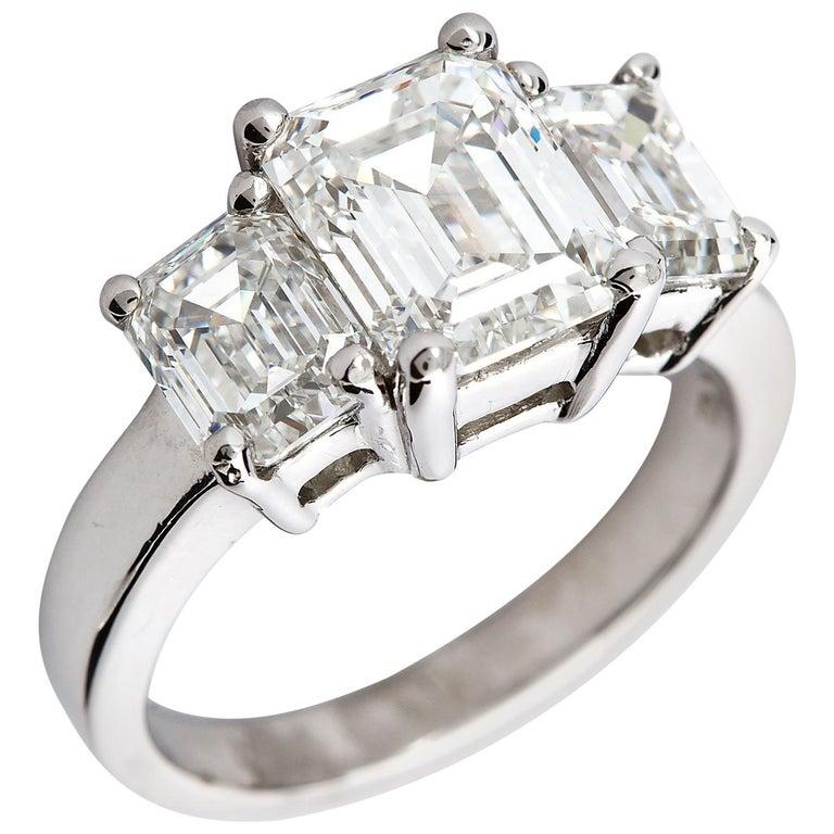 2.20 Carat Centre Three-Stone Emerald Cut Diamond Platinum Ring GIA Certified For Sale