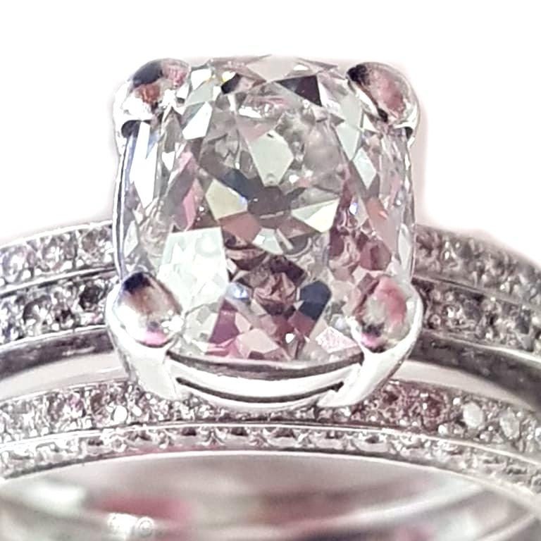 2.20ct European Old Cut Diamond With 2 Supporting Side Rings This set comprises 3 separate rings. The centre ring secures the 2.20ct old cut diamond in a cleverly made box setting allowing the two side rings to sit at either side. The principal
