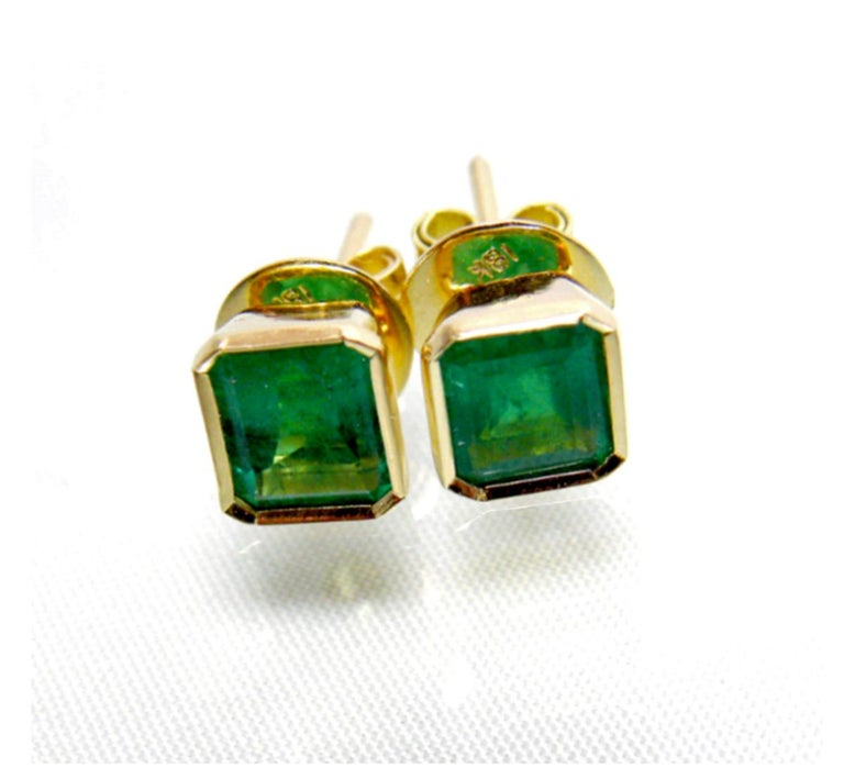 2.20 Carat Natural Emerald Stud Earrings 18k Yellow Gold Primary Stones: 100% Natural Colombian Emerald  Average Color/Clarity : Extraordinary Color AAA+ Medium Green/ Clarity, VS  Total Weight Emeralds: Approx. 2.20 Carats  Shape or Cut: Emerald