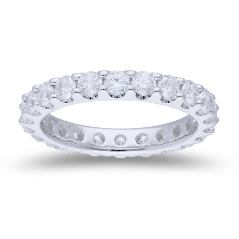 An amazing round diamond eternity ring set with 22 round diamonds.  The diamonds weight is 2.20 Carat, each diamond weight 0.10 Carat. The band rings is made to order, which means after receiving the order, we will specifically craft your rings