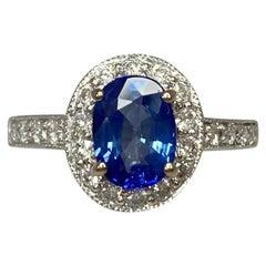 2.20 Carat Vivid Blue Sapphire and Diamond 18 Karat Gold Oval Cluster Halo Ring