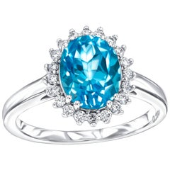 2.20ct Oval Cut Blue Topaz 0.20ct Round Diamond White Gold Engagement Ring