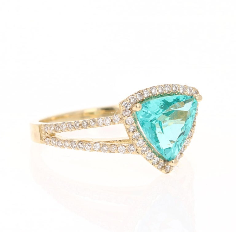 Unique and beautifully designed Apatite and Diamond Ring!    Apatites are found in various places around the world including Myanmar, Kenya, India, Brazil, Sri Lanka, Norway, Mexico and the USA. The sea blue color of Apatite is considered top grade