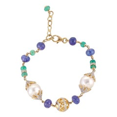 22.17 Carat South Sea Pearl Emerald Tanzanite Diamond 18 Karat Gold Bracelet
