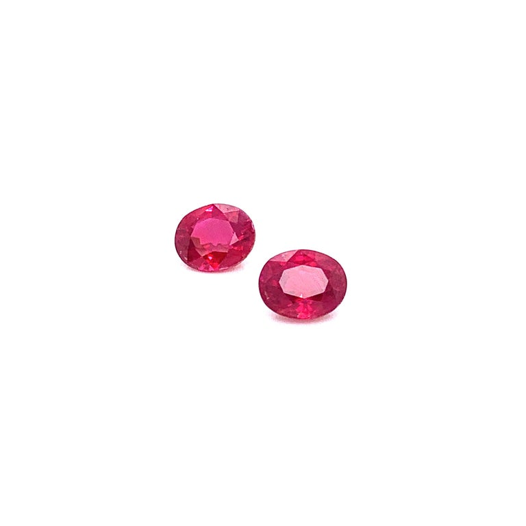 2.22 Carat GRS Certified Oval Burmese Pigeon's Blood Red Ruby Pair:  A very beautiful and elegant pair, it features two natural Burmese pigeon's blood red oval rubies weighing a total of 2.22 carat. The rubies have excellent cutting proportions, and
