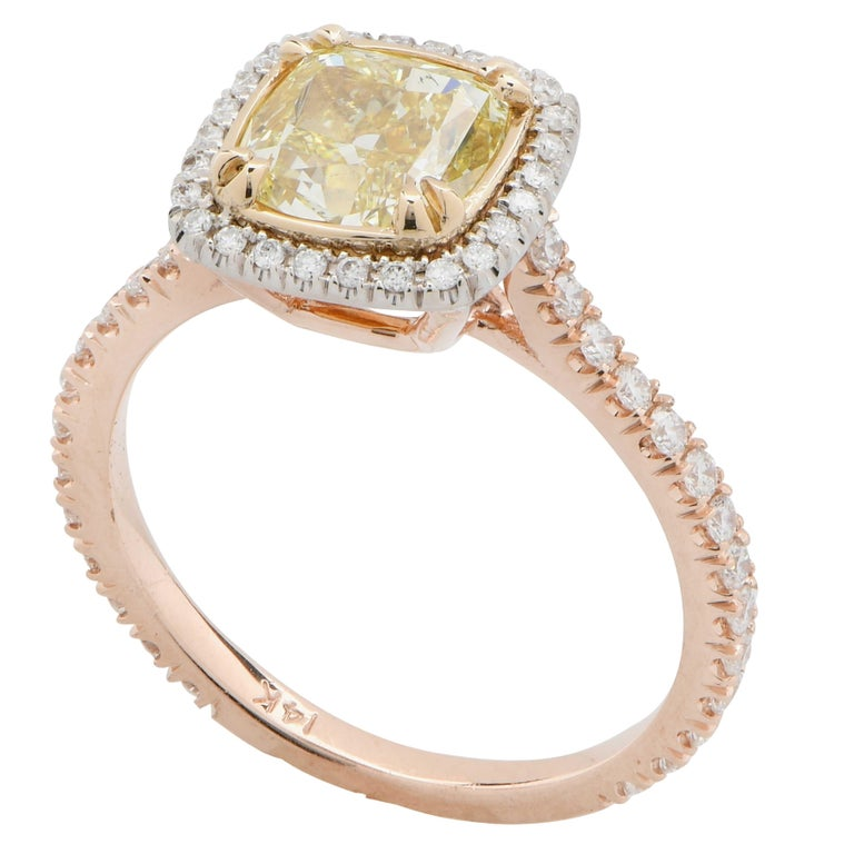 2.22 Carat Cushion Cut Diamond set in 14 Karat Yellow and White Gold Mounting with 54 round brilliant cut diamonds with an estimated total weight of .40 carats. Ring Size is 7 (can be sized) Metal Weight is 3.7 Grams