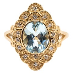 2.22 Carat Oval Aquamarine and Diamond Halo Cluster 9 Carat Yellow Gold Ring