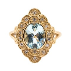 2.22 Carat Oval Aquamarine and Diamond Halo Cluster 9 Carat Yellow Gold Ring