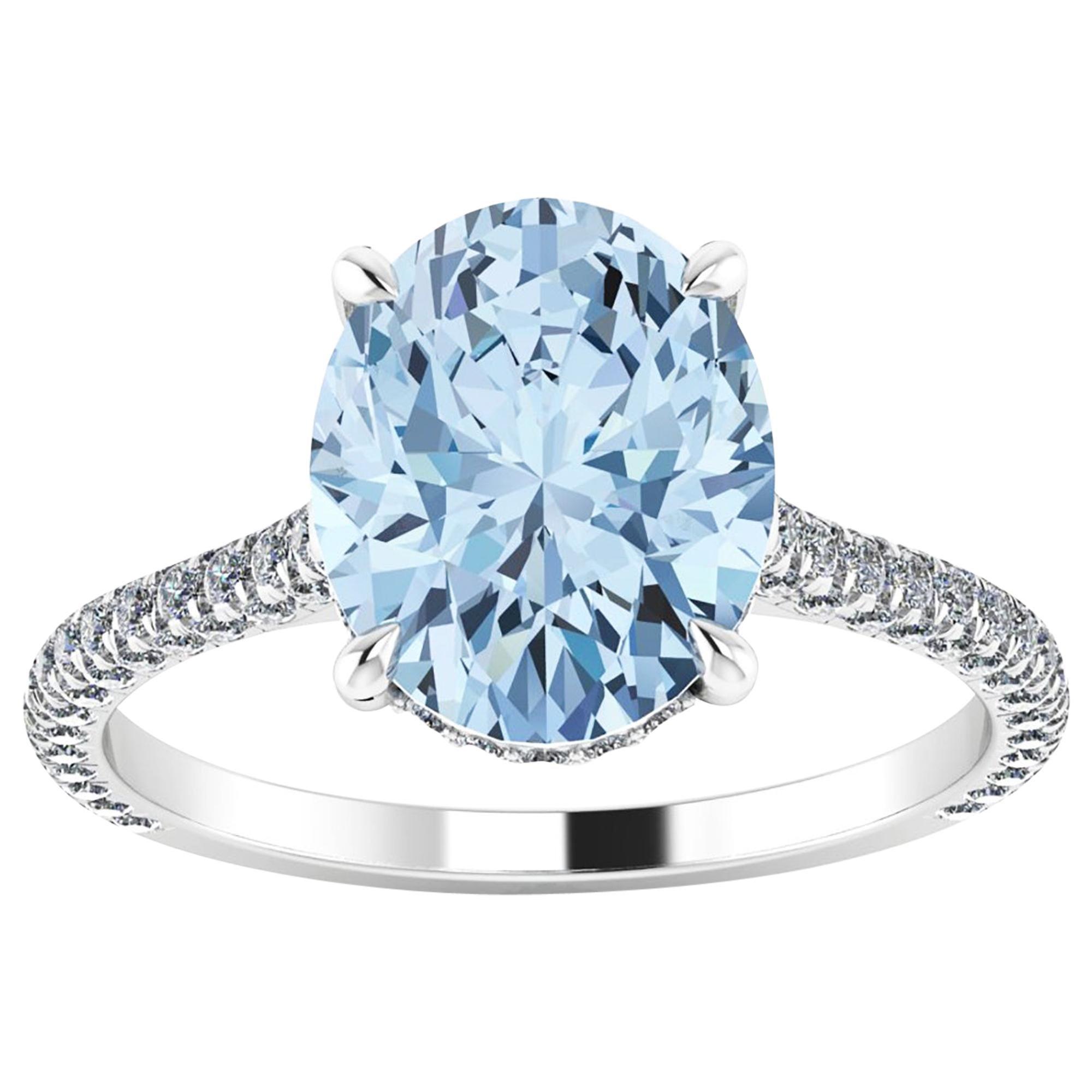 2.5 carat Oval Blue Aquamarine and White Diamonds Pave' in Platinum