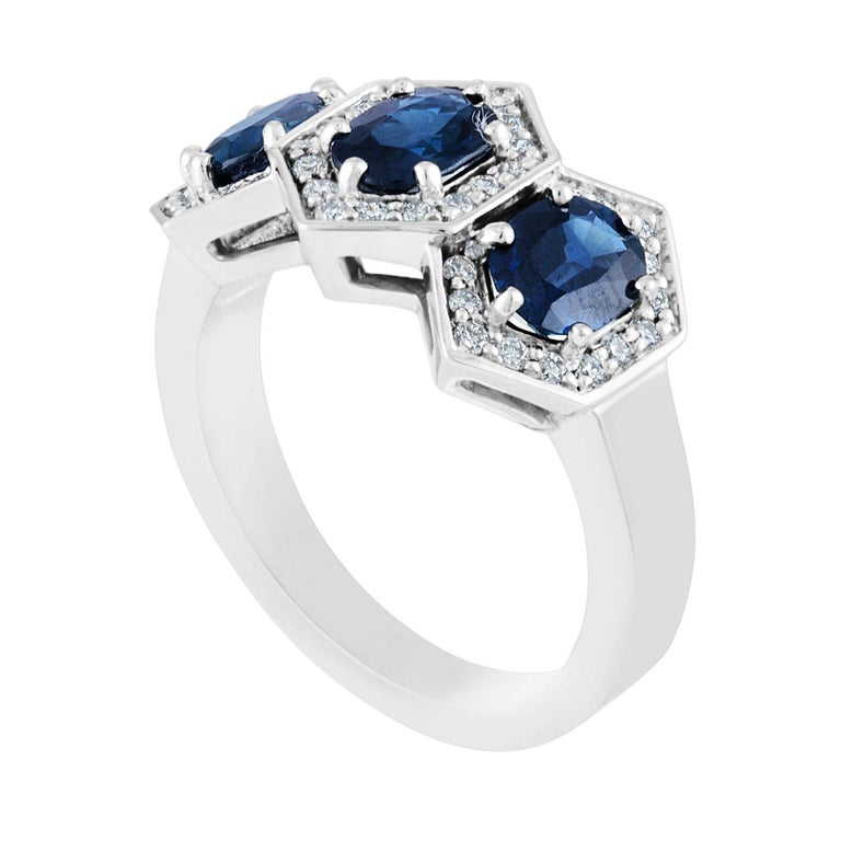 Three Stone Hexagon Band Ring The ring is 14K White Gold The ring has 3 Oval Sapphires 2.22 Carats The ring has 0.30 Carats Diamonds F/G VS The ring is a size 6.75, sizable. The ring weighs 6.4 grams