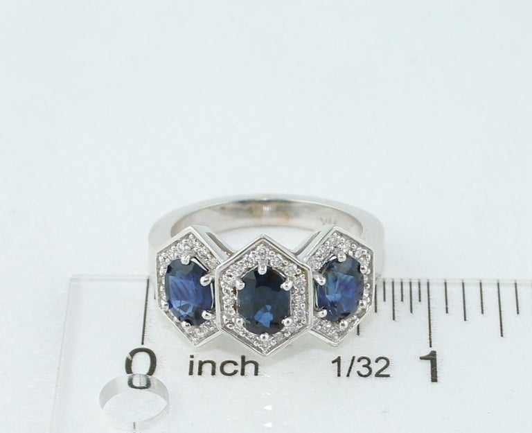 2.22 Carat Three-Stone Hexagon Blue Sapphire Diamond Gold Band Ring For Sale 1