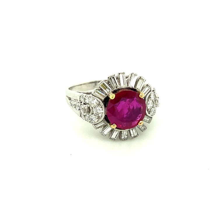 2.23 Carat Gubelin Certified Unheated Burmese Ruby and White Diamond Gold Ring:  A rare ring, it features an elegant Gubelin certified round-cut unheated natural Burmese red ruby weighing 2.23 carat, with white fancy-cut as well as round brilliant