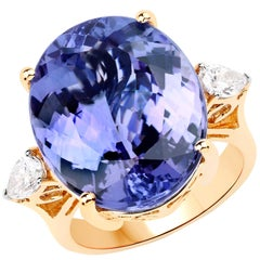 22.33 Carat Tanzanite and Diamond 18 Karat Yellow Gold Three-Stone Ring