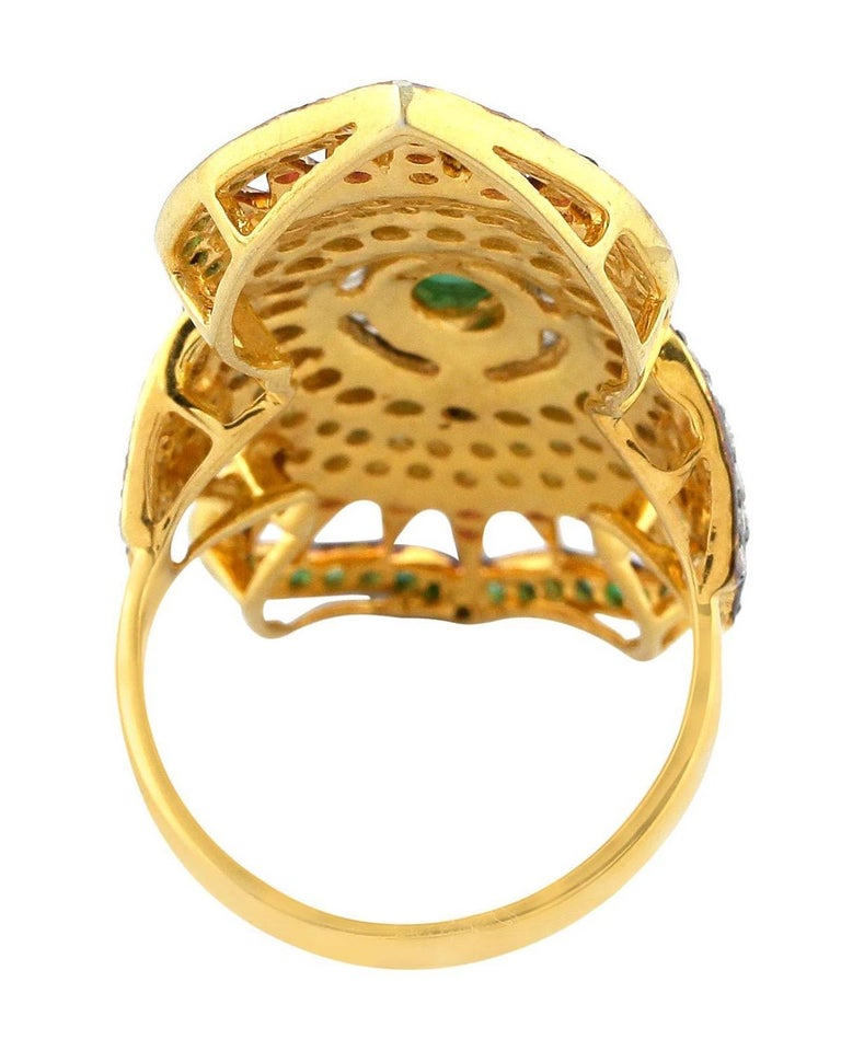 This ring has been meticulously crafted from 18-karat gold and sterling silver. Handcrafted in 2.24 carats emerald, .3 carats ruby, yellow sapphire & illuminated with 1.56 carats diamonds. Instock  The ring is a size 7 and may be resized to larger