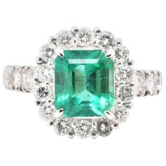 2.24 Carat Natural Emerald and Diamond Halo Engagement Ring Set in Platinum