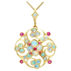 2.24 Carat Opal and Ruby Yellow Gold Pendant / Brooch