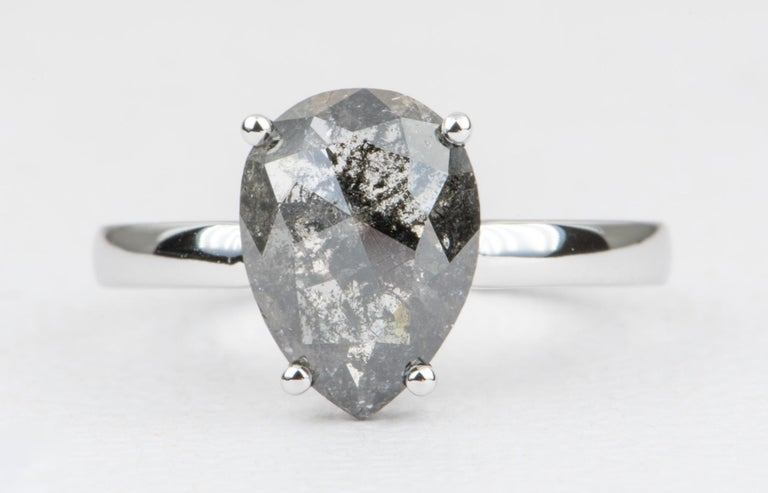 ♥  Solid 14K white gold ring set with a beautiful pear-shape salt and pepper solitaire diamond. ♥  The diamond has a solid four prong setting.  ♥  US Size 7  (Free resizing) ♥  Band width: 2.4 near the center stone. ♥  Gemstone: Natural solitaire
