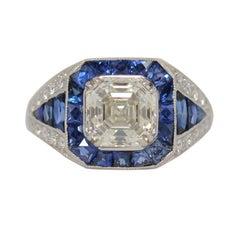 2.25 Carat Asscher Cut Diamond & Sophia D Platinum Setting with Blue Sapphires