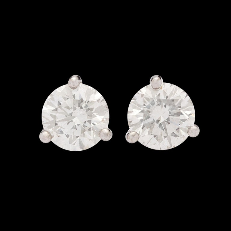 Two diamonds full of sparkle and fire come together to make one fantastic pair of stud earrings. Featuring EGL certificates that grade the stones as I color with VS1 and VS2 clarity, this exceptionally well matched pair weighs in at an impressive