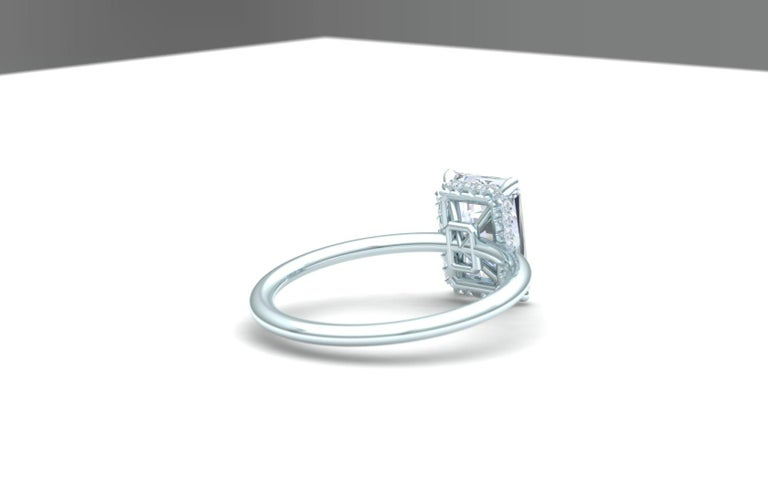 This GIA Certified Radiant Cut Diamond is set in a classic and clean platinum setting. The center stone is 2 carats and has a color and clarity of F-VS2. The diamond is set in a platinum four prong head and has a hidden halo below the center stone