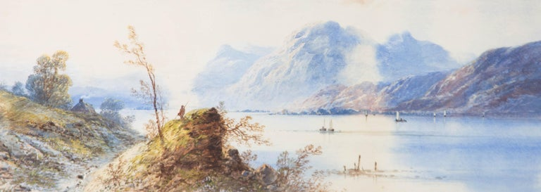 A beautifully proportioned watercolour by Edwin Earp, showing a lake in the foothills of a misty mountain. The lake is dotted with boats and a small cottage with a smoking chimney.  The painting has been presented in a glazed, gilt frame with a