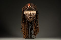 Dan Deangle Mask in Wood, Cowry Shells and Metal