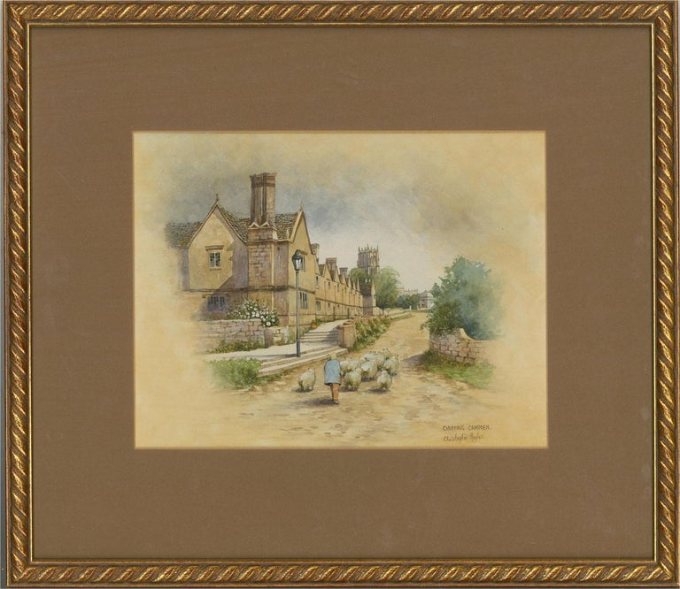 A street scene in the Cotswold market town of Chipping Campden. A figure herds a flock of sheep along the street. Presented glazed in a brown mount and a distressed gilt-effect wooden frame with twisted rope moulding at the edge. Signed and
