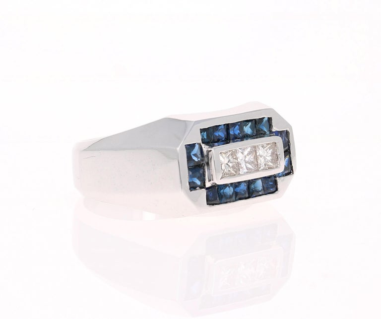 We also carry a unique Men's Collection of Wedding Bands & Rings!   This amazing piece is set with 14 Sapphires that weigh 1.60 Carats and 3 Princess Cut Diamonds that weigh 0.66 Carats. The Total Carat Weight of the ring is 2.26 Carats.   It is