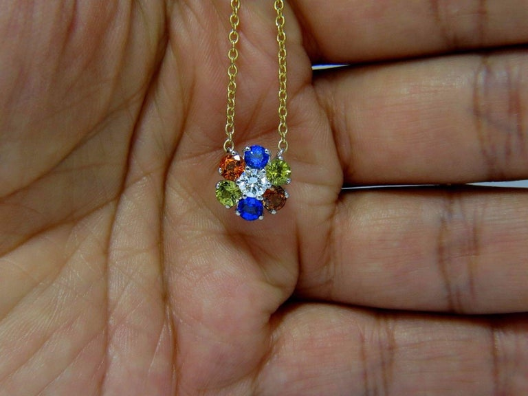 Multicolored Natural Gems stone cluster pendant & Necklace.  1.94ct natural multicolor sapphires  Bright Orange, Blue, Yellow & Pink.  .32ct round brilliant diamond  G-color Vs-2 clarity.  .44 inch diameter    14kt. yellow gold necklace & 14kt white
