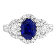 2.26 Carat Oval Cut Fine Ceylon Sapphire and Diamond Halo Ring in 18 Karat Gold
