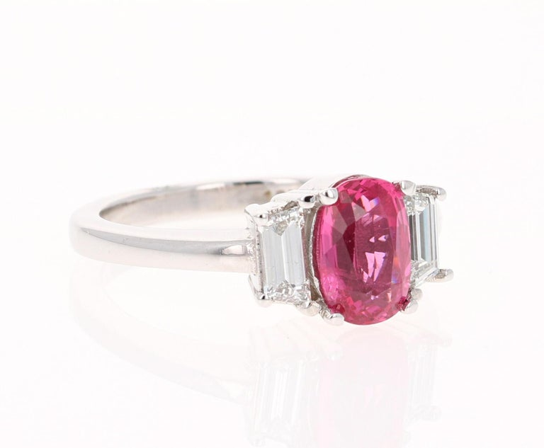This beautiful ring has all the characteristics to be a stunning Engagement/Bridal Ring!   The magnificent Oval Cut Spinel weighs 1.81 Carats and measures at 6 mm x 8 mm. Surrounding the Spinel are Baguette Cut Diamonds that weigh 0.48 Carats.