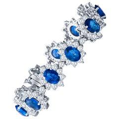22.96 Carat Oval Blue Sapphire and 13.47ctw Round Diamond Halo Floral Bracelet