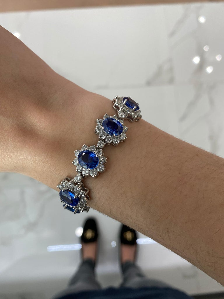 Oval Cut 22.96 Carat Oval Blue Sapphire and 13.47ctw Round Diamond Halo Floral Bracelet For Sale