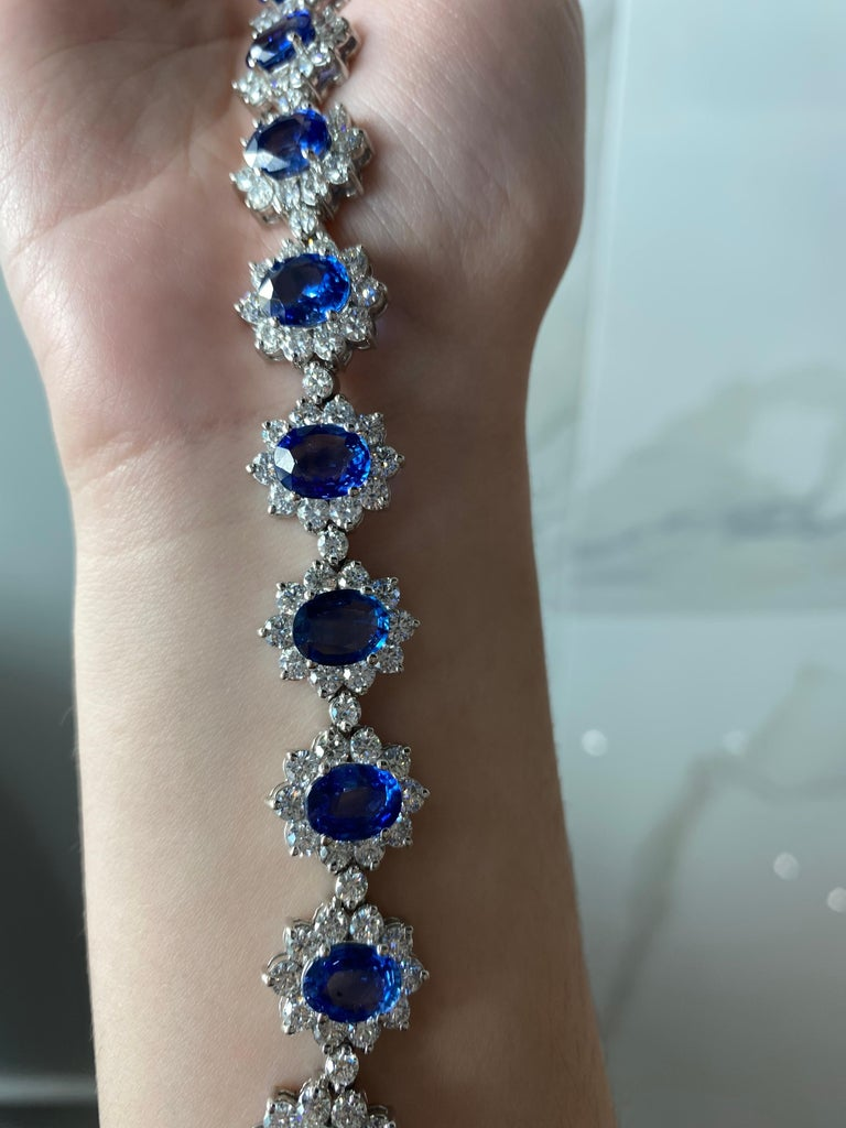 Women's or Men's 22.96 Carat Oval Blue Sapphire and 13.47ctw Round Diamond Halo Floral Bracelet For Sale