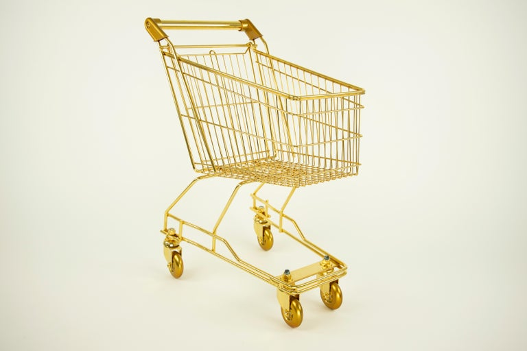 The'22-Karat Gold Cart for Kids' is the ultimate luxury accessory and usable sculpture! It is made of 22-Karat Gold plated stainless steel and brass with smooth ball bearing skateboard wheels. It moves smoothly across the floor. The sculpture