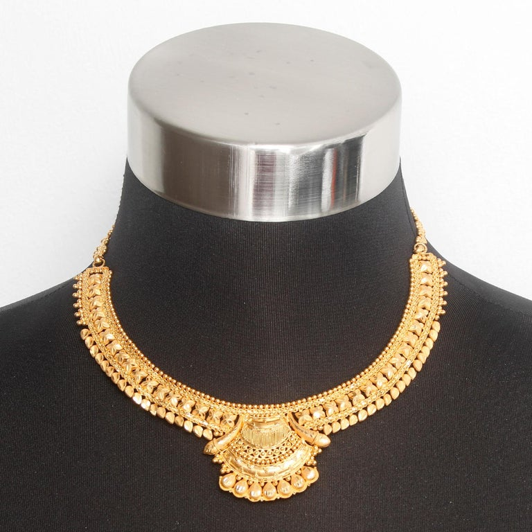 22K  Yellow gold Indian Design Necklace  - Beautifully ornate choker like necklace. Set in 22K yellow gold. Total weight 35.7 grams. Total length 8 inches. Falls perfect on the neck. Pre-owned with custom box .