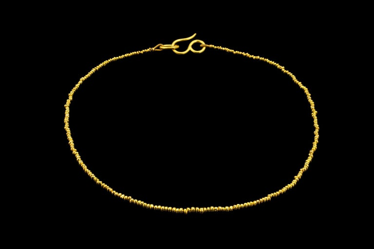 22k yellow gold beads are individually handmade, each unique with an organic shape. Strung on a monofilament cord and finished with Loren Nicole signature oversized s-hook clasp.   Listing is for 18