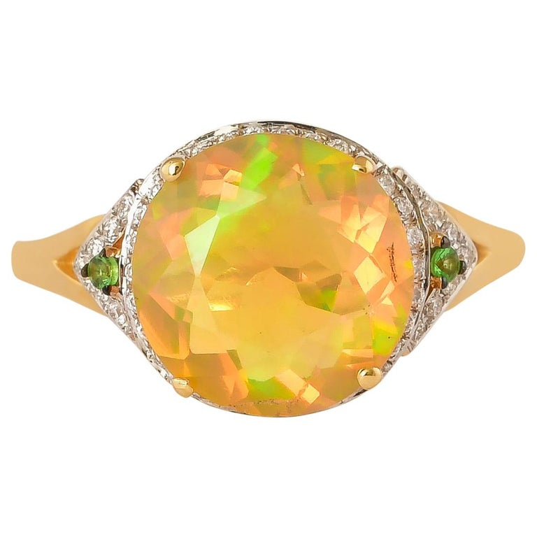 2.3 Carat Ethiopian Opal with Tsavorite and Diamond Ring in 18 Karat Yellow Gold For Sale