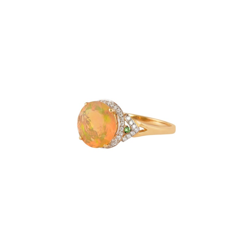 Contemporary 2.3 Carat Ethiopian Opal with Tsavorite and Diamond Ring in 18 Karat Yellow Gold For Sale