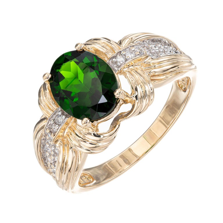 Tourmaline and diamond ring. Oval center green tourmaline with 24 full cut accent diamonds in a 14k yellow gold setting.   Top gem bright green Tourmaline approx. total weight 2.30cts, 9 x 7mm 24 full cut diamonds approx. total weight .20cts, H,