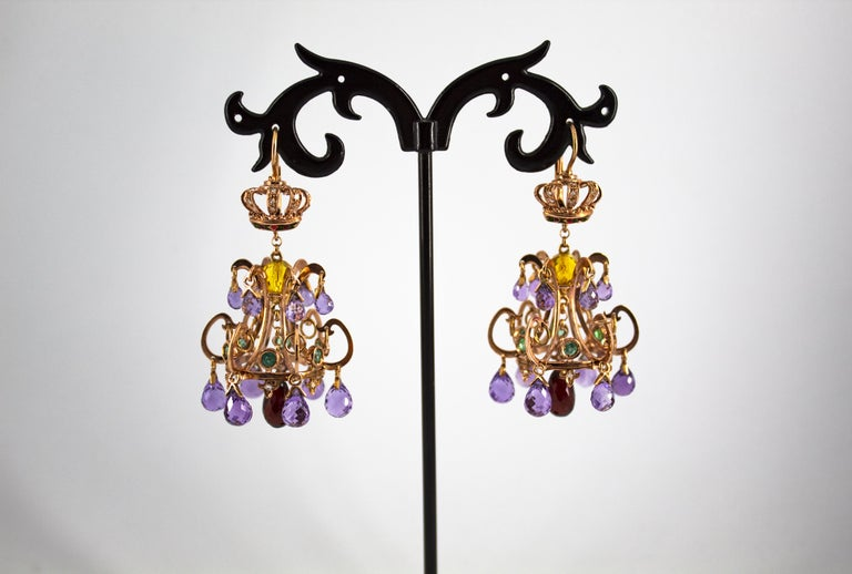 These Lever-Back Earrings are made of 14K Yellow Gold. These Earrings have 0.25 Carats of White Diamonds. These Earrings have 0.84 Carats of Emeralds. These Earrings have 18.00 Carats of Amethysts. These Earrings have 2.00 Carats of Citrine. These