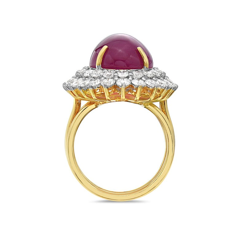 This cocktail features a 23.15 carat ruby surrounded by approx 3.40 carats of G VS diamonds set in 18K yellow gold. 20 grams total weight. Size 7 1/4. Made in Italy.   Resizeable upon request.   Viewings available in our NYC showroom by appointment.